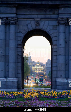 View through an arch of Alcala Gate, nocturnal. Madrid, Spain. - Stock Photo