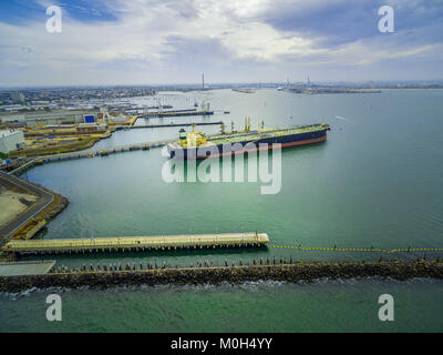 Aerial view of large industrial nautical vessel moored at docks in Williamstown, Melbourne, Australia - Stock Photo