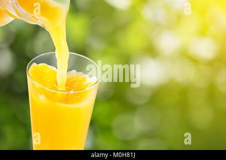 pouring orange juice - Stock Photo