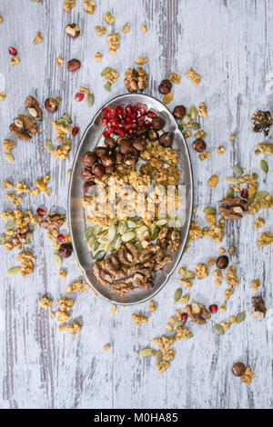 top view of granola ingredients on plate on wooden table - Stock Photo
