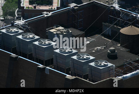 Exhaust vents of industrial air conditioning and ventilation units on a Skyscraper roof top in New York, Manhattan, - Stock Photo