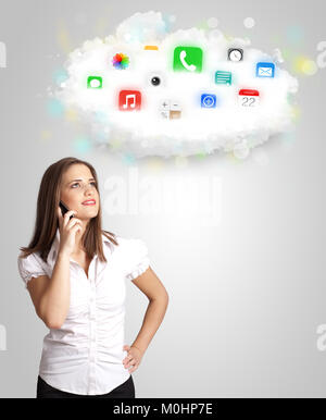 Young woman presenting cloud with colorful app icons and symbols concept - Stock Photo