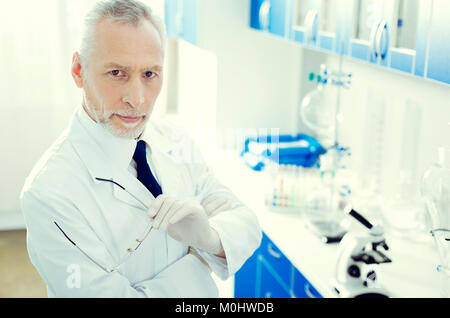 Serious mature researcher posing and looking into camera - Stock Photo