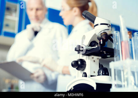 Low angle shot of microscope in lab - Stock Photo