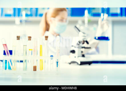 Close up test tubes with colorful chemical liquids - Stock Photo