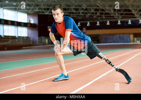 Disabled  Runner Stretching in Stadium - Stock Photo