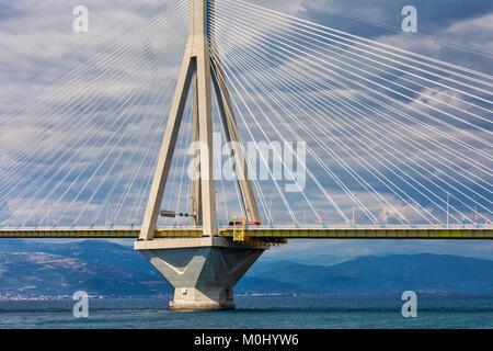 View of suspension bridge Rio-Antirio in Greece. Bridge crossing Corinth Gulf strait, Peloponnese, Greece - Stock Photo