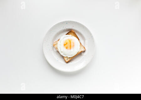breakfast with fried egg on toast - Stock Photo
