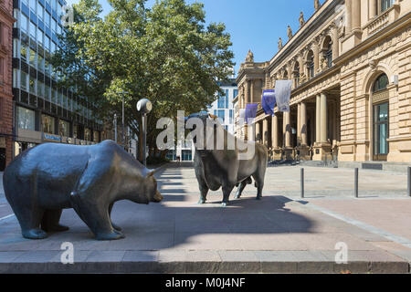 The bull and bear sculpture, bronze figures in front of the German Stock Exchange, Frankfurt, Germany - Stock Photo