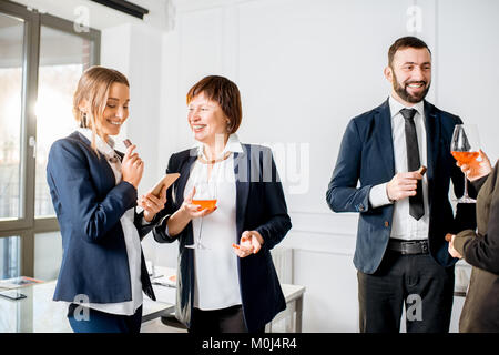 Business people during the meeting with drinks in the office - Stock Photo