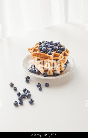 plate with stack of tasty fresh waffles with blueberries - Stock Photo