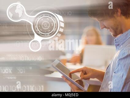 Man using tablet with graph overlays - Stock Photo