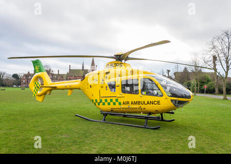 The Hampshire and Isle of Wight Air Ambulance helicopter, Eurocopter EC135, lands at Reading School to transfer - Stock Photo