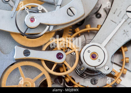 Clock transmission macro view. Stopwatch chronometer mechanism cogs gears wheels connection concept. Shallow depth - Stock Photo