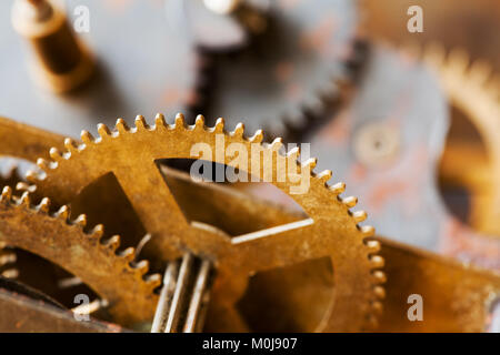 Cog gear wheel mechanic machinery ornament on vintage textured paper background. Retro technology parts closeup, - Stock Photo