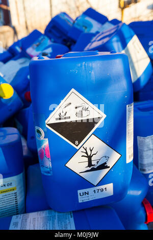 Abandoned plastic drums of liqued chlorine on La Gomera, Canary Islands. - Stock Photo