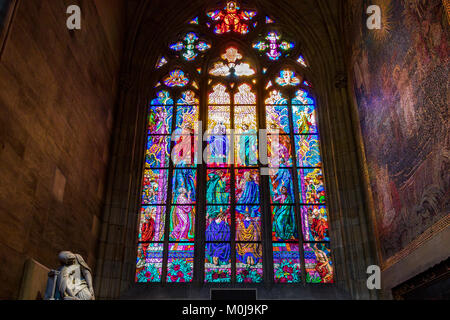 The chapel of St Ludmila in Prague's St Vitus Cathedral features the beautiful stained glass Pentecost stained glass - Stock Photo