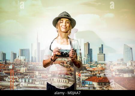 Woman traveler on the Milan city background - Stock Photo