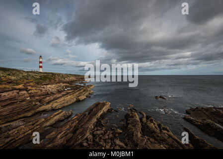 The Tarbat Ness Lighthouse is located at the North West tip of the Tarbat Ness peninsula near the fishing village - Stock Photo