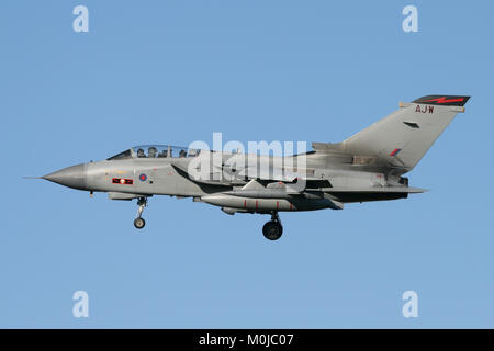 RAF Tornado GR4 carrying the markings of 617 Squadron, the famous Dambusters on the turn into RAF Marham in Norfolk. - Stock Photo