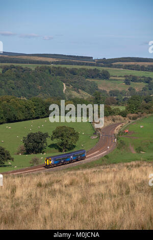Scotrail sprinter train passes  Upper Denton (west of Haltwhistle in the Tyne Valley) with a Newcastle - Glasgow - Stock Photo