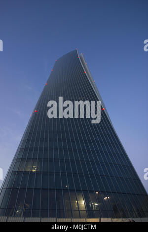 an unusually interesting wide angle shot from below of the 'Hadid Tower' at dusk, Milan, Italy - Stock Photo