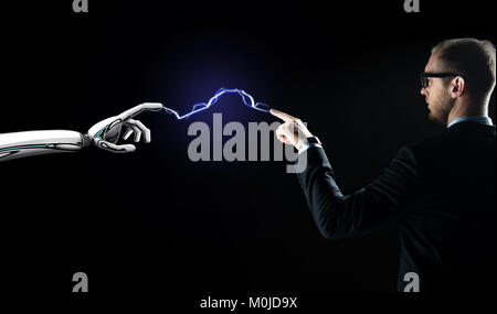 robot and businessman connected by lightning - Stock Photo