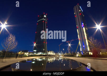 The Isozaki and Hadid tower in the CityLife District of Milan from the park entrance at dusk - Stock Photo