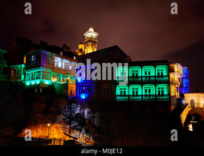 Narikala fortress and Public Sulfuric bath with colorful lighting at night in central Tbilisi, Georgia - Stock Photo