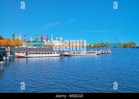 HAMBURG, GERMANY- AUGUST 13, 2015: Passenger ships towed on lake Alster, Hamburg, Germany on a bright day in Fall - Stock Photo