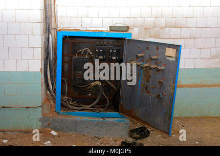 Old power distribution board. Premises of a destroyed and plundered milk production plant. The raiders captured - Stock Photo