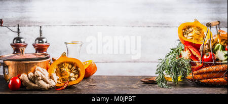 Autumn seasonal  cooking concept. Various autumn seasonal organic vegetables: pumpkin,carrot,paprika,tomatoes,ginger - Stock Photo