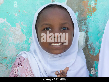 Young girl in traditional dress for the Mawlid festival, Lamu Island, Kenya - Stock Photo