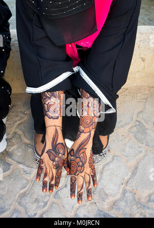 Woman wearing a burqa showing her henna painted hands, Lamu Island, Kenya - Stock Photo
