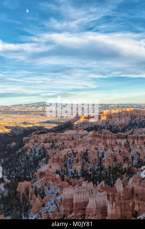 Crested moon rise over the Bryce Canyon on an early winter evening, Bryce Canyon National Park, Utah, United States. - Stock Photo