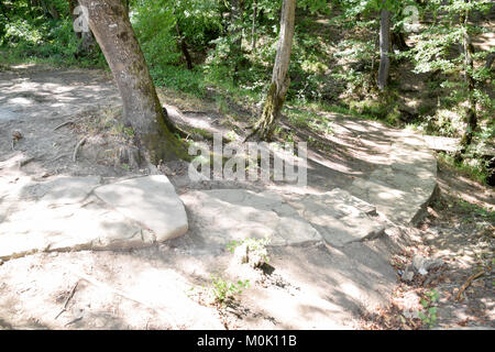 path laid out of stone slabs. A path in the mountains. - Stock Photo