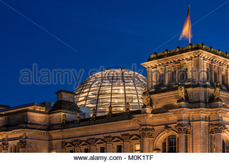 Reichstag Building illuminated at night in Berlin. Seat of the german parliament. close-up shot. Europe, Germany, - Stock Photo