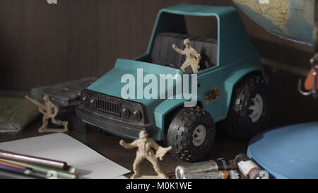Toy Soldiers and Tanks. Miniature toy soldiers on board. - Stock Photo