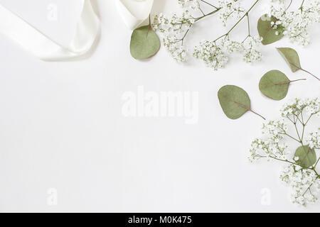 Styled stock photo. Feminine wedding desktop mockup with baby's breath Gypsophila flowers, dry green eucalyptus - Stock Photo