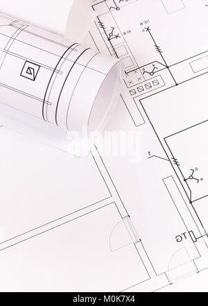 Rolls Of Diagrams Or Electrical Construction Drawings And Work Tools