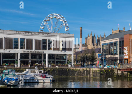 Bristol Floating Harbour showing the Cathedral and a ferris wheel - Stock Photo