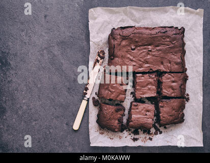 Homemade Chocolate Brownies on a slate background - Stock Photo