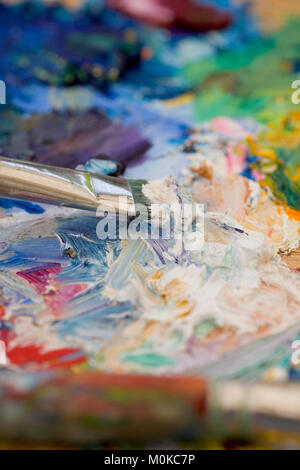 Artists oil paints and brushes multi coloured close up semi abstract