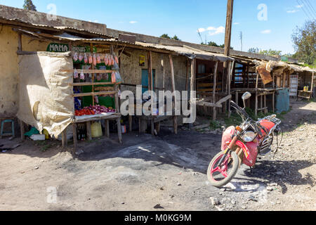 Lifestyle scene of a row of homes with makeshift shop fronts in Nanyuki, Kenya. - Stock Photo