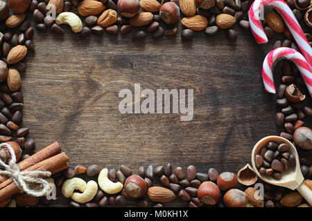 Different nuts on a wooden table. Cedar, cashew, hazelnut, walnu - Stock Photo