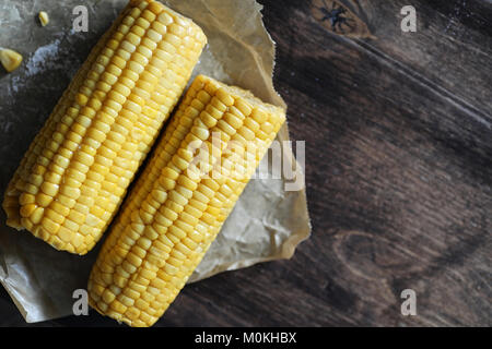 Boiled corn cob with salt on a wood - Stock Photo