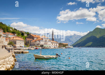 Classic view of the historic town of Perast located at world-famous Bay of Kotor on a beautiful sunny day in summer, - Stock Photo
