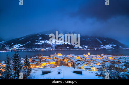 Panoramic view of Zell am See with Zeller See lake in twilight during blue hour at dusk in winter, Salzburger Land, - Stock Photo