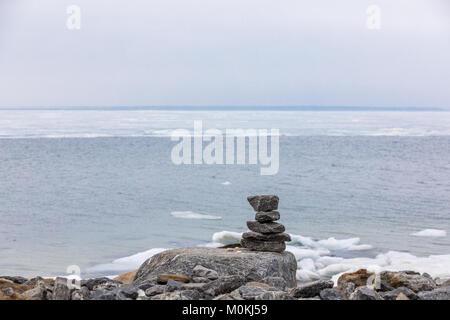 pile of rocks on a rocky beach - Stock Photo