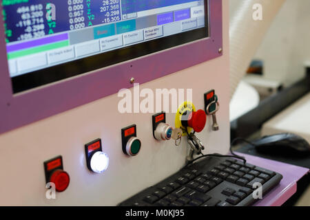 Control panel of a computer controlled machine. Selective focus. - Stock Photo
